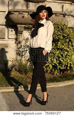 Beautiful Ladylike Woman Wearing Elegant Blouse,pants And Hat