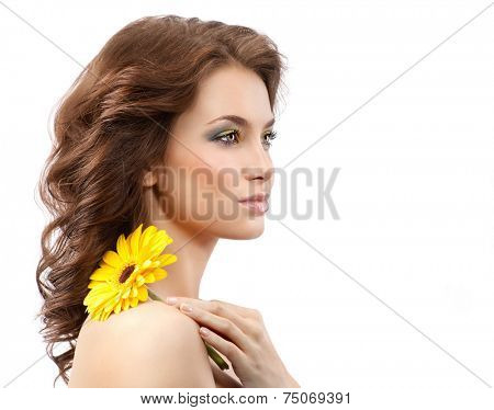 closeup portrait of attractive  caucasian young woman brunette isolated on white studio shot lips face skin hair head and shoulders makeup flower yellow spring summer