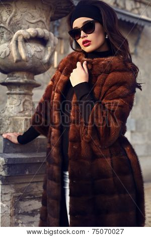 Beautiful Woman In Luxurious Fur Coat And Sunglasses