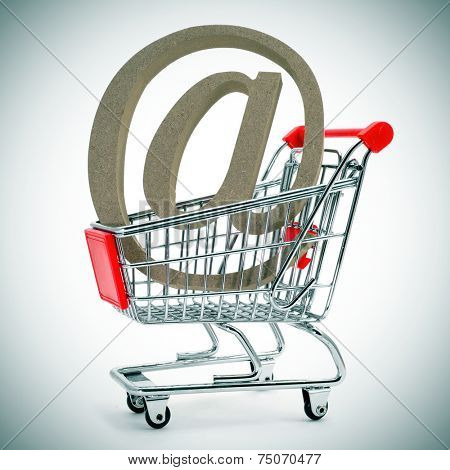 an at sign in a shopping cart, depicting the concept of e-shopping or e-commerce