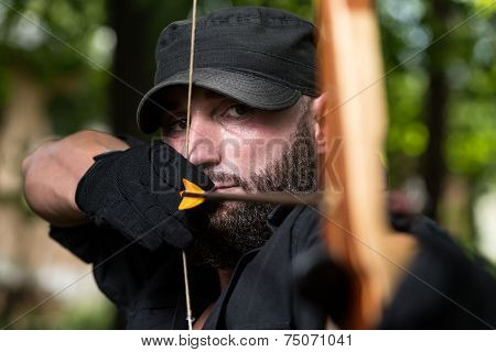 Man With A Bow And Arrows In Woods