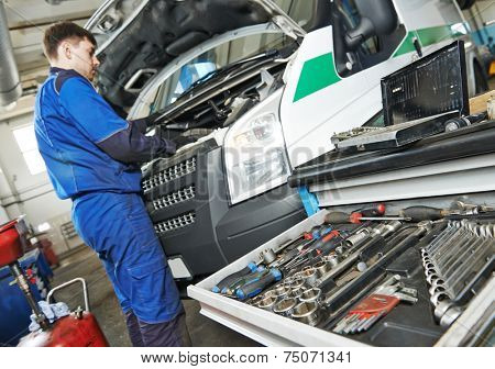 auto repairman industry mechanic worker servicing car auto in repair or maintenance shop service station