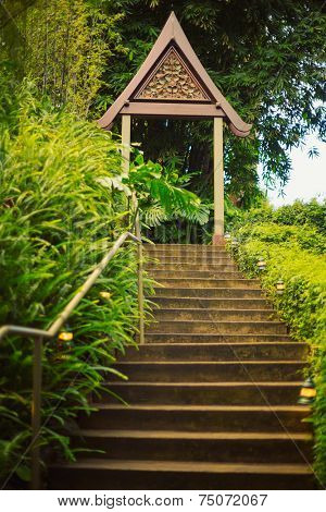Tropical Staircase at Sunset with Zen Buddhist Arch