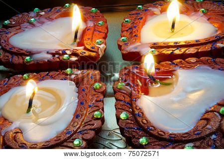 Lit Earthenware Diyas For Diwali