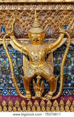 Golden ornamental buddhist figure in Bangkok