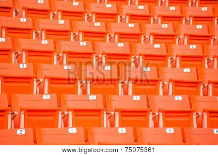 red seats on stadium steps bleacher