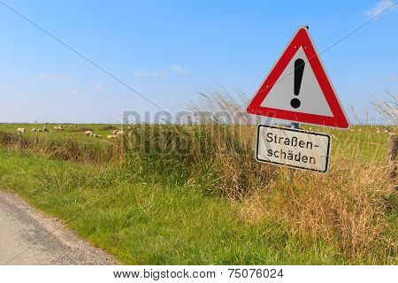 German Road Sign Warning Of Road Damage