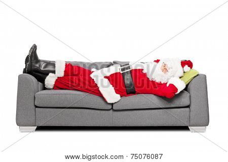 Santa Claus sleeping on a modern sofa isolated on white background