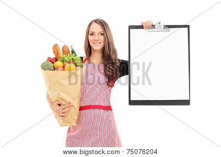 Woman holding grocery bag and a clipboard isolated on white background