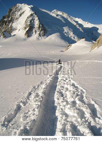 Climber making tracks in fresh snow crossing the Col Du Midi