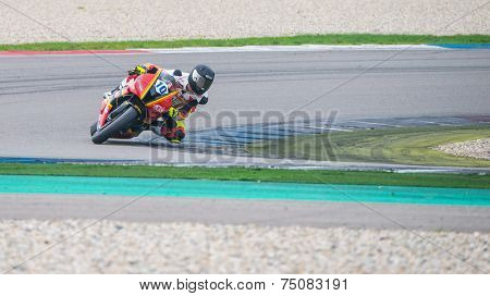 ASSEN, NETHERLANDS - OCTOBER 17, 2014: Driver 10 races through corner 3 during the free trials of the 1000cc motorbike division