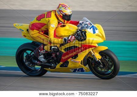 ASSEN, NETHERLANDS - OCTOBER 19, 2014: Competitor number 74 racing through the apex of the 1000cc superbike races on the TT Assen circuit