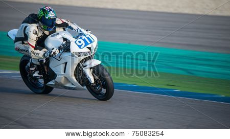 ASSEN, NETHERLANDS - OCTOBER 19, 2014: Competitor number 911racing through the apex of the 1000cc superbike races on the TT Assen circuit