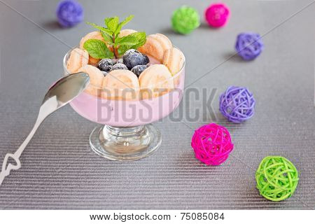 Yogurt Dessert With Savoiardi Or Ladyfingers Biscuits And Blueberry And Mint For Garnish