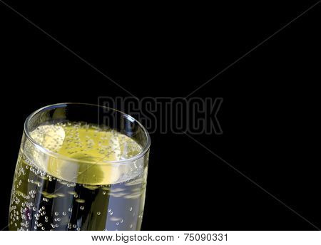 Close up image of top of full champagne glass