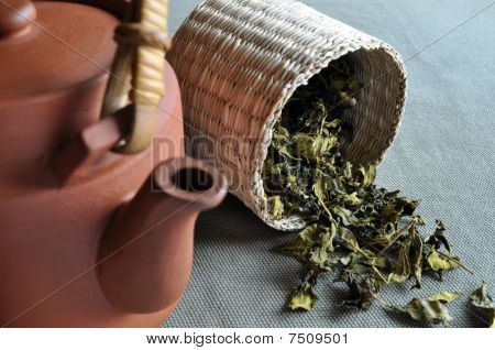 Basket of tea and clay teapot