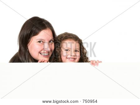 Mother And Daughter Holding A Card