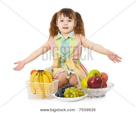 Little Girl With Big Heap Of Different Fruits