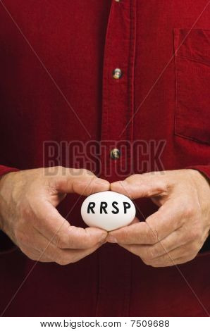 RRSP On Egg Held By Man