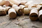 stock photo of merlot  - Bunch of wine corks on wooden table - JPG