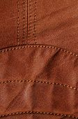 picture of nylons  - Detail picture of nylon seams in a brown leather jacket - JPG