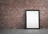 image of interior sketch  - Blank poster frame leaning against a red brick wall - JPG