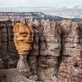 pic of hoodoo  - Colored hoodoo at Bryce Canyon National Park with mountains on background - JPG