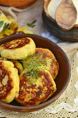foto of patty-cake  - potato patties with fried bacon and onions - JPG