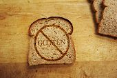 foto of wheat-free  - Slice of bread with Gluten text  - JPG