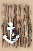picture of driftwood  - Decorative anchor with abstract driftwood design on beach sand background - JPG