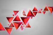 pic of tetrahedron  - red volume triangles on a light background with lighting effects - JPG