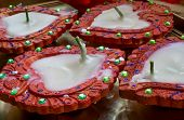 picture of diwali lamp  - Earthenware lamps decorated with colors and gems with wax candles - JPG