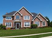 stock photo of dream home  - Exterior of a large two story brick residential home containing plenty of copy space - JPG
