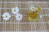 stock photo of chamomile  - chamomile and chamomile tea on a wooden table - JPG