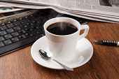 pic of peppy  - cup of coffee and the newspaper and pause at work - JPG