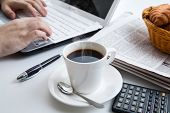 pic of peppy  - businessman running and a cup of coffee on him desktop - JPG