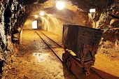 stock photo of underpass  - Underground train in mine carts in gold silver and copper mine - JPG