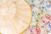 stock photo of dong  - Vietnamese money dong with asian style hat on top view - JPG