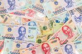 picture of dong  - Vietnamese money dong random spread background texture - JPG