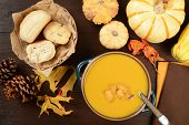 stock photo of butternut  - A bowl of butternut squash soup from a high angle view - JPG