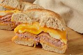image of bagel  - A ham egg and cheese breakfast sandwich on a multi grain bagel - JPG