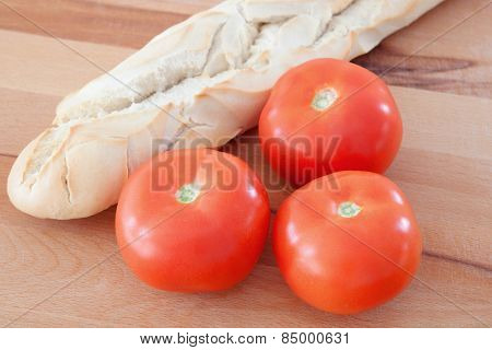 Loaf of bread with tomatoes delicious breakfast