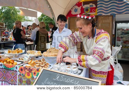 Saleswoman In Traditional Costume On Apple Feast Day