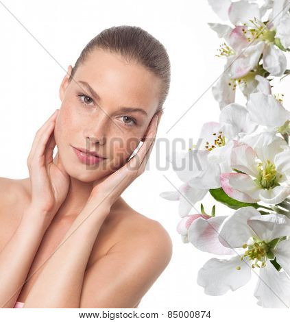 closeup portrait of attractive  caucasian smiling woman brunette isolated on white studio shot lips  face  head and shoulders looking at camera spring flowers