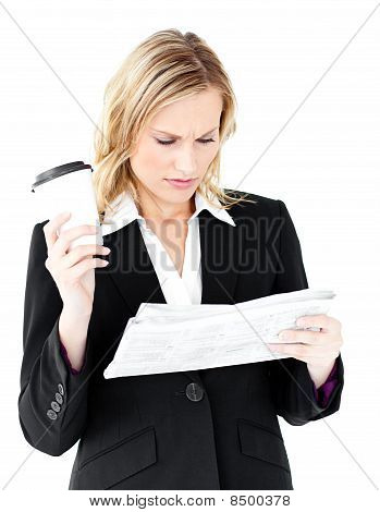 Attractive Businesswoman Reading A Newspaper Holding A Coffee