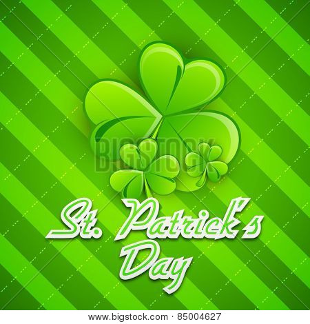 Happy St. Patrick's Day celebration greeting card design with glossy Irish lucky shamrock leaves on green background.