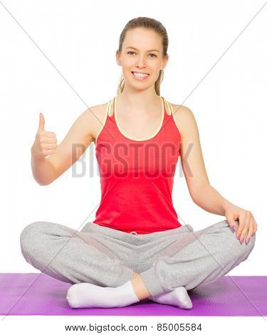 Young sporty girl sits is lotus pose isolated