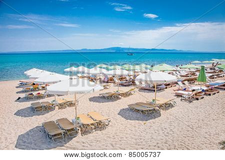 HANIOTI, GREECE - MAY 26, 2014 : Beautiful sandy beach on May 26. 2014 in Hanioti, Kasandra peninsula , Greece. Kasandra peninsula visit more than 200 000 European tourists every year.