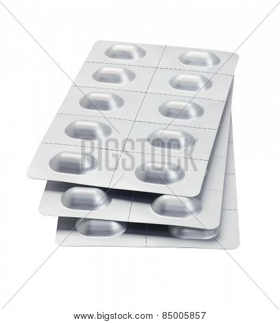 Stack Of Medicine In Blister Packs On White Background