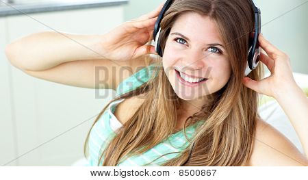 Smiling Young Woman Listen To Music